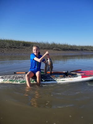 Brownette Roseana Olson 13, of Savannah recently went paddleboard fishing off Butterbean flats near The Landings and caught three spottail bass.