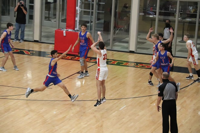 Dale's Palmer Jones sinks a 3-pointer against the Silo Rebels Thursday night at Dale.