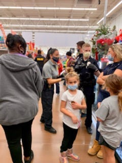 Local agencies shopped with 136 kids Thursday night at the annual Shop with a Cop event in Shawnee.