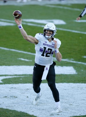 Northwestern quarterback Peyton Ramsey passes against Michigan State during the first half of an NCAA college football game, Saturday, Nov. 28, 2020, in East Lansing, Mich.