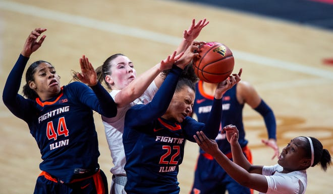 Illinois' Kennedi Myles, left, and Eva Rubin vie for a rebound against Nebraska's Isabelle Bourne and Sam Haiby, right, during an NCAA college basketball game Thursday, Dec. 10, 2020, in Lincoln, Neb. (Kenneth Ferriera/Lincoln Journal Star via AP)