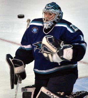 IceCats goalie Curtis Sanford keeps a close eye on the puck during a 2004 game.