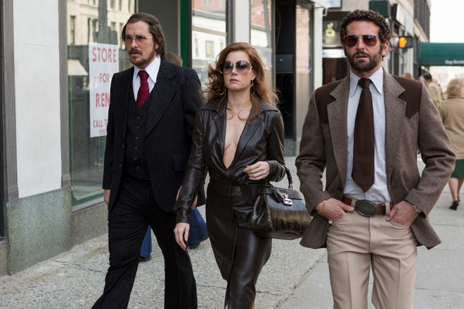 """Christian Bale, Amy Adams and Bradley Cooper walk down Main Street in Worcester in a scene from """"American Hustle."""""""