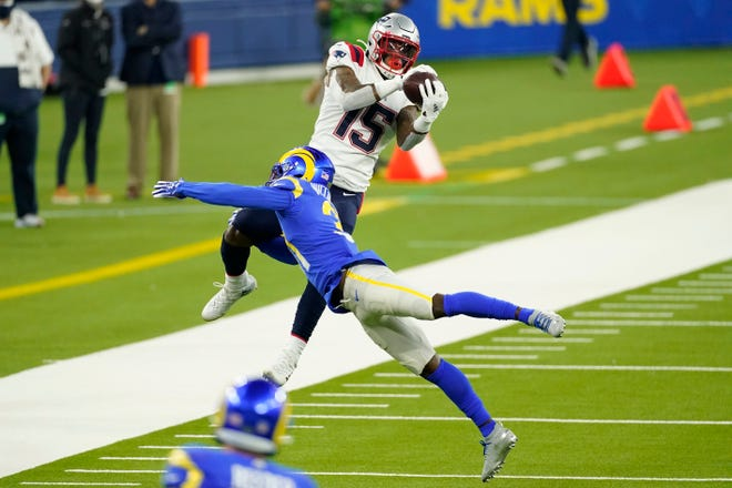 Patriots wide receiver N'Keal Harry makes a catch over Los Angeles defensive back Darious Williams during the second half of Thursday's game.