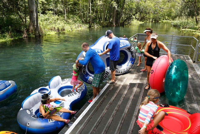 Families load their children into tubes before leaving from the midpoint launch dock along on the Ichetucknee River at Ichetucknee Springs State Park near Fort White in August 2017. The Ichetucknee River Alliance is trying to ban tubing on the shallower upper portion of the Ichetucknee because they say tubers are killing grasses and other plant life on the river floor.