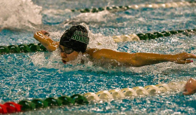 Pueblo County High School's Kandi Liberato swims the butterfly in the 200 IM Jan. 17, 2020, during the Hornet Invite at Pueblo County High School.