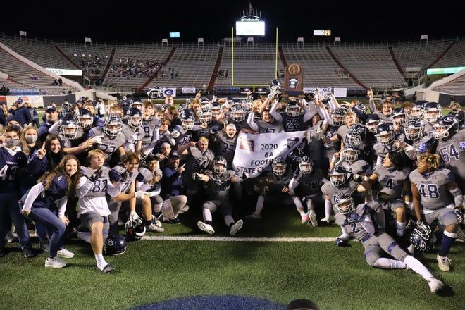 Greenwood fans celebrate with the Bulldog football team after Greenwood won the 2020 6A State Championship, Saturday, Dec. 5, beating Lake Hamilton at War Memorial Stadium.
