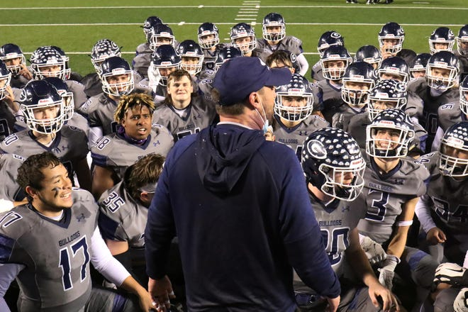 Greenwood players kneel to listen to head coach Chris Young after winning the 6A championship, Saturday, Dec. 5, at War Memorial Stadium in Little Rock. [JAMIE MITCHELL/TIMES RECORD]