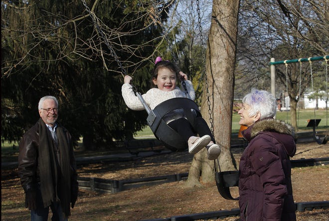 Jon and Barb Wills play with their granddaughter, Juliette Jones, at Fancyburg Park on Dec. 9. After the purchase of the property at 3333 Kioka Ave., the city of Upper Arlington plans an expansion to the park for 2024.
