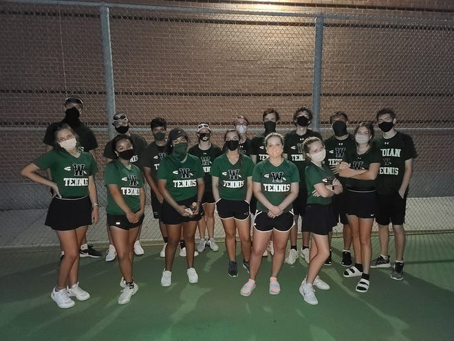 The Waxahachie High School tennis team poses for a photo at the start of  the 2020 fall season. The Indians garnered eight selections on the all-District 11-6A team, and head coach Nicholas Tanner was named Coach of the Year.