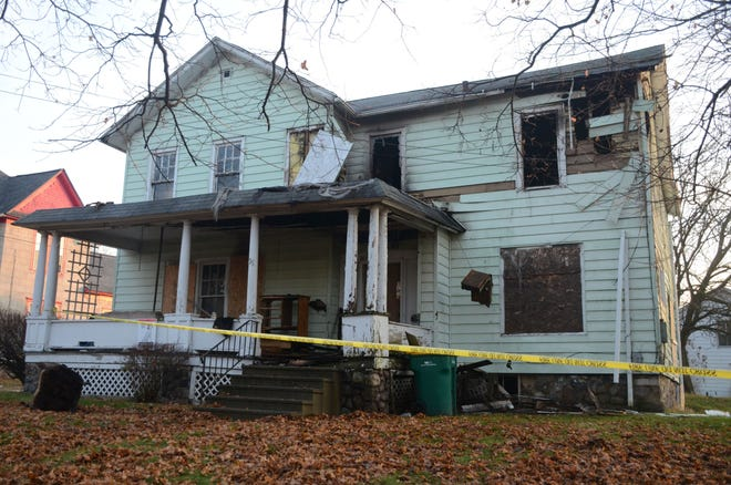 Fire damaged this vacant house at 35 Elm St. Thursday night. The cause remains under investigation.  (Trace Christenson/The Enquirer)