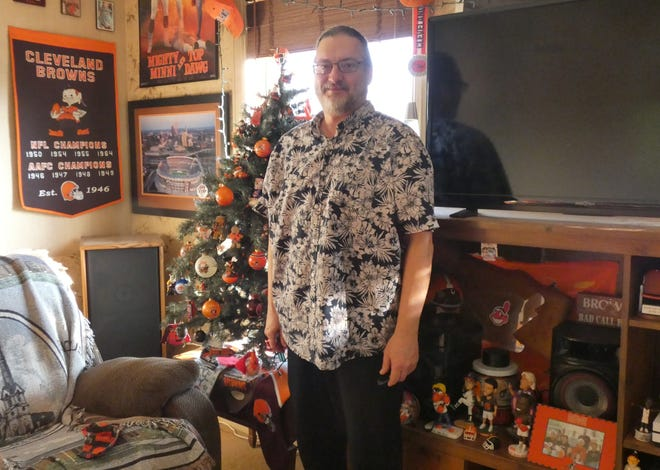 The living room of Jeff Panovich's apartment is filled with Cleveland sports memorabilia, including a Browns-themed Christmas tree.