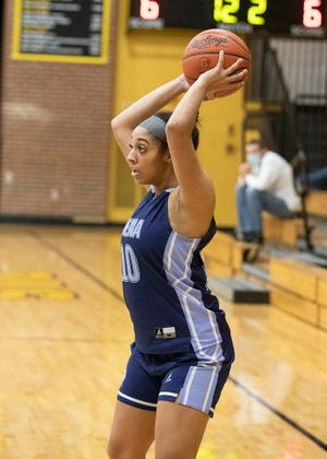 Adena junior Jaden Smith looks for an opportunity to pass the ball during a game against Paint Valley earlier in the season. Adena defeated Unioto Tuesday night 50-40 making them 7-0 for the season.