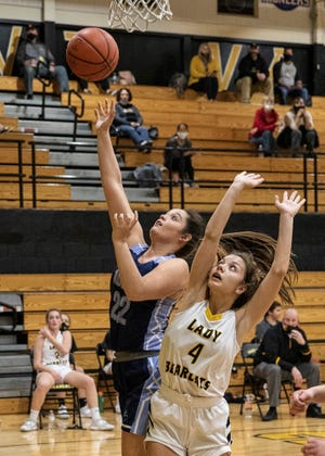 Adena's Emma Lovely takes  it to the rim Thursday night at Paint Valley High School. Adena defeated Paint Valley 56-44.