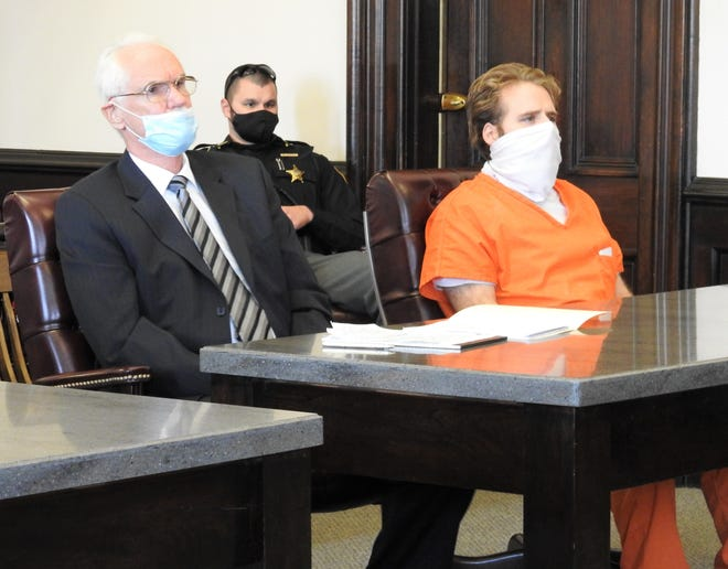 Attorney Edward Rauch with client Jermiah Daniel Friday in Coshocton County Common Pleas Court. Daniel received a minimum of 11 years in prison, mandatory, and maximum of 16.5 years for the rape of a 12-year-old girl in July 2019.