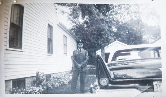 Tom Stephenson poses for a portrait in 1963 after returning home from Basic Training in a family photo seen on Thursday, Dec. 10, 2020, in Norwalk, IA. An Air Force veteran, Tom Stephenson loved working on cars and often helped his family and friends fix theirs. Tom passed away in August from COVID-19.