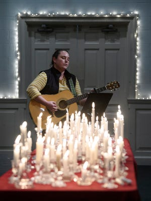 """Andria Reed sings """"Amazing Grace"""" during the Homeless Memorial Service held at The Gathering Church in Downtown Evansville, Ind., Thursday night, Dec. 10, 2020."""