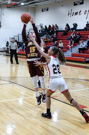 Berne Union senior point guard Emily Blevins shoots the ball over Liberty Union's Delaney Peck during a non-conference game Thursday.The Rockets defeated the Lions 42-34.