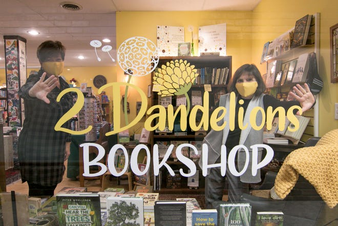 2 Dandelions Bookshop owners Jeri Kay Thomas, left, and Jeanne Blazo, shown Thursday, Dec. 10, 2020, prepare to say goodbye to their old location on Main Street in Brighton, moving to a new spot across the street in the former Impulse Clothing Boutique building.