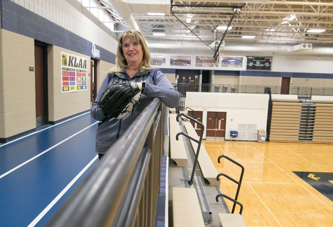 Hartland High School athletic secretary Anna Devitt is retiring after 23 years at her alma mater. She pitched on Hartland's first softball teams in 1974 and 1975 and played volleyball for the Eagles.