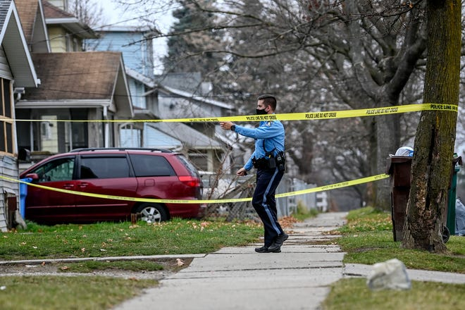 Lansing police investigate the scene of a suspicous death on the 1200 block of Malcom X Street on Friday, Dec. 11, 2020, in Lansing.