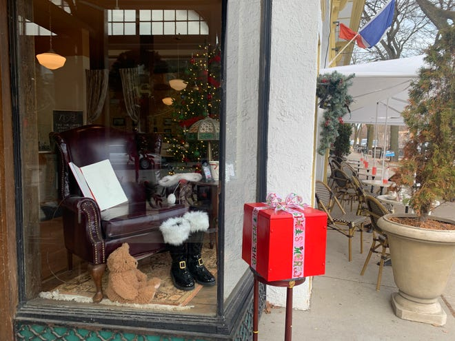 North Shore Boulangerie in Shorewood has figured out a way for children to still tell Santa their wishes and get a gingerbread cookie while minding the pandemic. Remote control is involved.