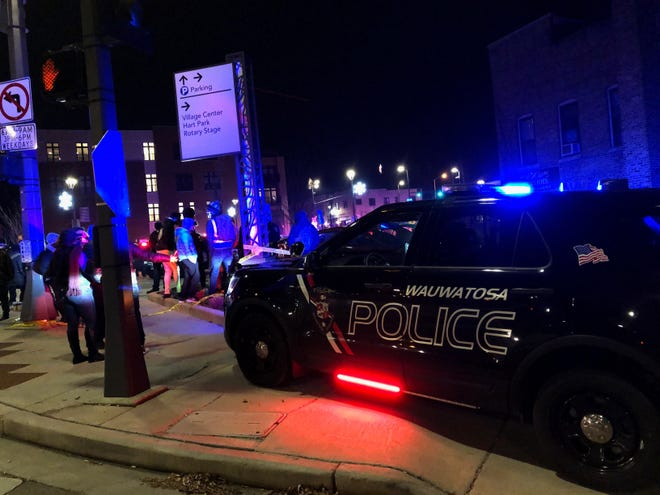 Wauwatosa police closed roads near the village area after an officer shot and injured a woman there Thursday night.