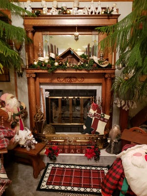 The fireplace at the Williams home is ready for Christmas, with a nativity scene made by Marsha Williams' dad.