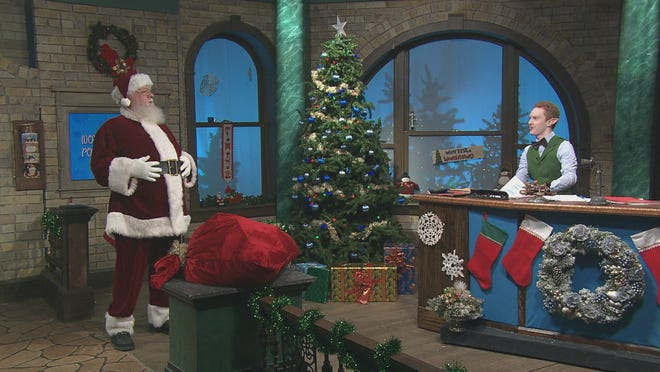 """Santa, left, and Jolly the Postmaster Elf talk naughty and nice from a socially safe distance during Milwaukee PBS' taping of """"Letters to Santa."""""""