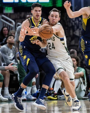Bucks guard Pat Connaughton, right, battles for the ball with Pacers forward Doug McDermott on March 4, the last time the Bucks played a game at Fiserv Forum.