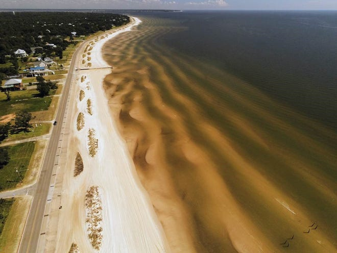 An aerial view of sandbar features near Bay St. Louis, Mississippi. Researchers at NRL's Ocean Sciences Division study coastal features to determine how they evolve and impact coastal infrastructure. The division is a partner in the new Gulf Coast Tech Bridge announced Dec. 9.