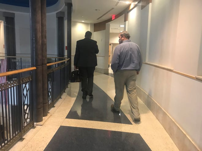 Attorney Robbie Beal and County Commissioner Dwight Jones exit the court room at Williamson County Circuit Criminal Court. Jones was charged with domestic violence in January. His next court appearance is scheduled for Jan. 22 when he will make a plea or request a trial.