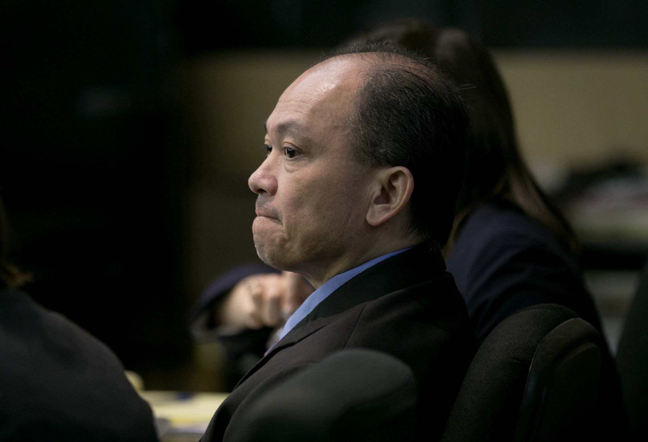 Jimmy Dac Ho listens to closing arguments during his 2014 murder trial at the Palm Beach County Courthouse in West Palm Beach.