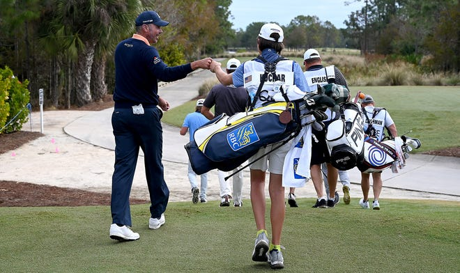 Matt Kuchar walking off with first tee with his caddy and son  Cameron Kuchar during the QBE Shootout at the Tibur—n Golf Club in Naples,Friday,Dec.11,2020.(Photo/Chris Tilley)
