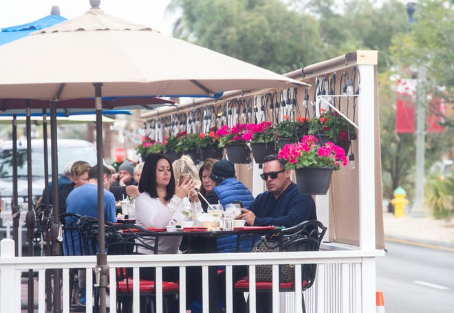 Unmasked patrons have lunch last Friday at Armando's Dakota Bar and Grill on El Paseo in close proximity to one another. The restaurant has opted to disregard the state's stay-at-home order to reduce COVID-19 infections.