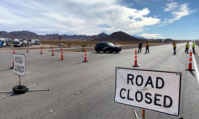 U.S. Highway 95 is closed after at least five bicyclists have been killed and four others injured in a crash involving a box truck, Thursday, Dec. 10, 2020 near Boulder City, Nev. (Christopher DeVargas/Las Vegas Sun via AP)
