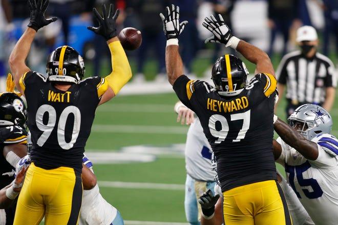 Steelers outside linebacker T.J. Watt and defensive end Cameron Heyward defend against a pass by Dallas Cowboys quarterback Garrett Gilbert.