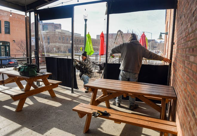 Wind barriers are installed on the outdoor patio on Friday, December 11, at Bread and Circus in Sioux Falls.