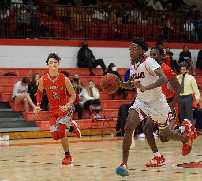 Vero Beach guard Almando Cyrius races the ball upcourt with Centennial's Sean Dunckley in pursuit during the Fighting Indians' 75-45 victory on Thursday, Dec. 11, 2020.