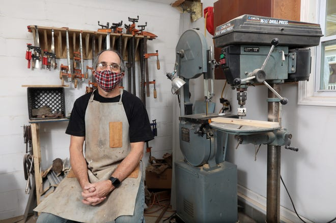 Joe Dosch is custom woodworker, who builds everything from cabinetry and furniture to signs.