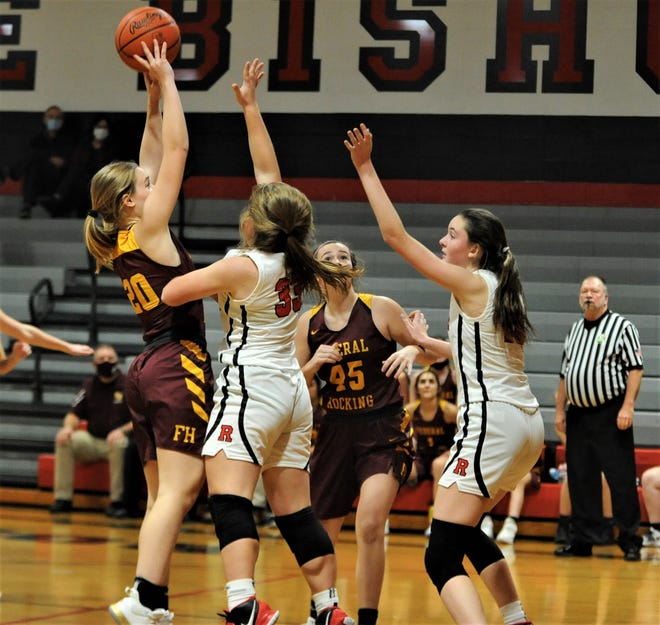 Rosecrans' Abby Solt (33) and Jenna McLaughlin defend a shot by Federal Hocking's Ava Tate on Thursday. The Lancers won 52-25.