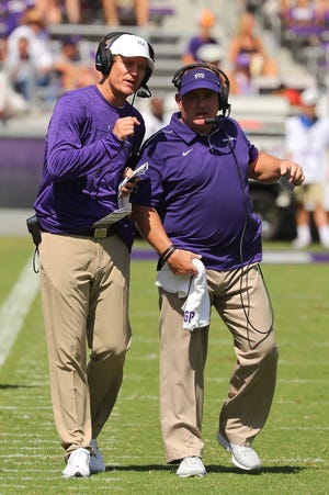 Sonny Cumbie, left, talks with TCU coach Gary Patterson during a 2019 game in Fort Worth. Cumbie is returning to Texas Tech, where he played and coached, to be the Red Raiders' offensive coordinator. He spent the past seven seasons at TCU, as co-offensive coordinator, then offensive coordinator and quarterbacks coach the entire time.