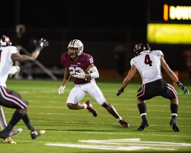 Israel Morgan of Round Rock gets past DJ Johnson. Round Rock won a bidistrict football playoff game 35-21 over Lake Travis at home on Friday.