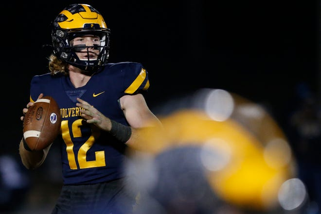 Prince Avenue's Brock Vandagriff (12) looks to throw during an GHSA high school football game between Prince Avenue Christian and Eagle's Landing Christian in Bogart, Ga., on Friday, Dec. 11, 2020. Prince Avenue Christian won 38-0. (Photo/Joshua L. Jones, Athens Banner-Herald)
