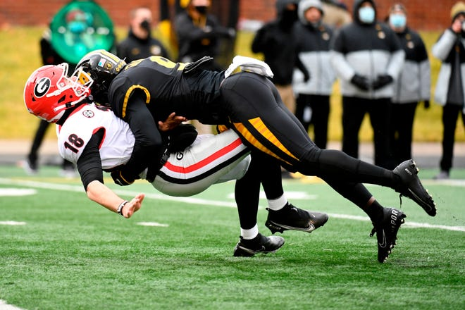 Missouri safety Tyree Gillespie hits Georgia quarterback JT Daniels as he throws during a game in 2020.