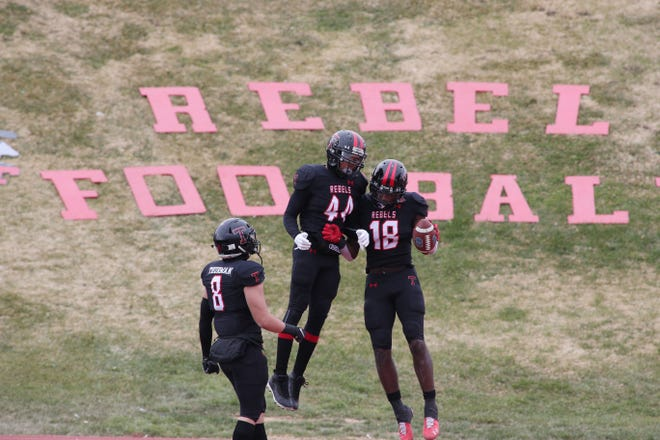 Tascosa Rebels Darius Sanders and Zaiquan Pinkard celebrate during the game against the El Paso Chapin Huskies at Dick Bivins Stadium Friday afternoon.  Michael C. Johnson/For the Amarillo Globe-News