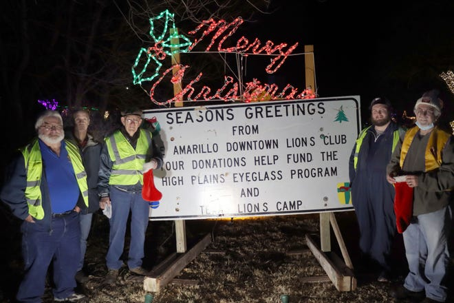 Mike Poole, Robert Taylor, Max Faulkner, Tanner Stevens and Ron Kordas with the Amarillo Downtown Lions Club collect donations during the Bishop Hills annual neighborhood Drive Through Christmas Light displays.