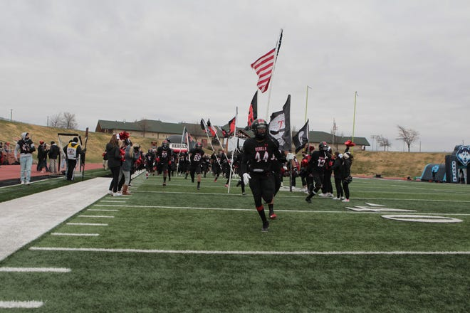 The Tascosa Rebels enter the field before the game against the El Paso Chapin Huskies at Dick Bivins Stadium Friday afternoon. Michael C. Johnson/For the Amarillo Globe-News