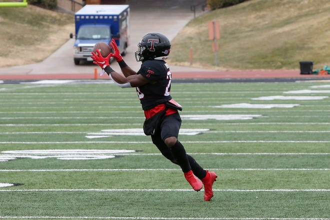 Tascosa Rebels L'Travion Brown catches a pass for a touchdown against the El Paso Chapin Huskies in the first half at Dick Bivins Stadium Friday afternoon. Michael C. Johnson/For the Amarillo Globe-News