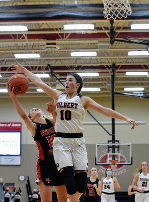 Gilbert's Ava Hawthorne comes up to block a shot by North Polk's Lucy Schaeffer during the second half of the No. 2 Tigers' 50-45 win over the Comets Friday at Gilbert.